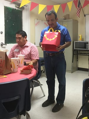 Principal Paul Covey was surprised with a McDonald's-themed birthday celebration Friday because he eats McDonald's regularly.