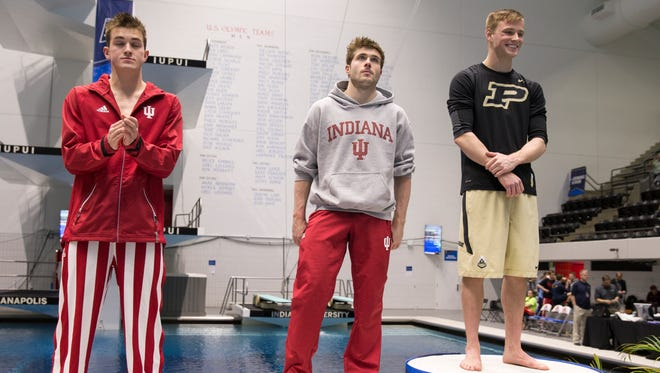 James Connor (left), and Michael Hixon of Indiana, stand in third and second to the first place award won by Steele Johnson of Purdue, NCAA Men's Division 1 Swimming and Diving Championships, Thursday, March 23, 2017.