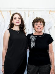 Jenna Burnett, left, owner of the newly remodeled CoCo's Bridal Boutique, poses with Yvonne Hershey, the shop's previous owner of 35 years.