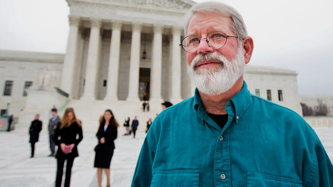 John Dennis Apel, stands in front of the Supreme Court in Washington following an argument on the right to protest at a military base. Apel had been barred from entering any part of Vandenberg Air Force Base on the central California coast, including the protest area on a public highway that passes near the main gate.