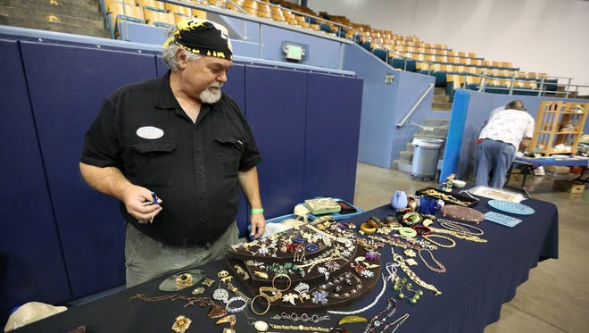 """Randy Houser of Albany shows off his costume jewelry at the Salem Collectors & Flea Market Sunday, Oct. 18, 2015, at the Salem Armory. Houser has been collecting costume jewelry for 30 years. """"It's been a fun hobby,"""" he said."""