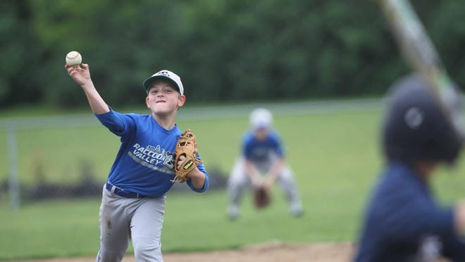 Dodgers pitcher Evan Smithson thows a pitch during a game with the Red Sox. This is the 60th anniversary season of the Raccoon Valley Little League.