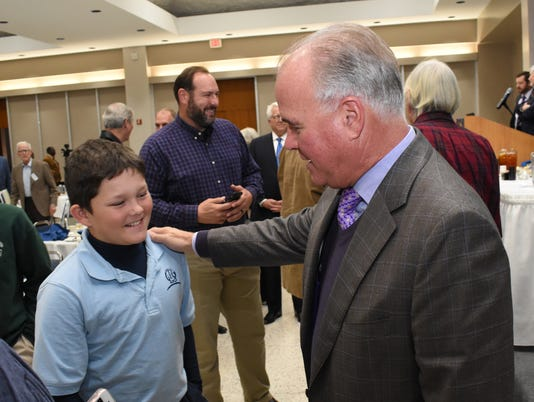 Lane Evans, 10 (left) meets LSU baseball coach Paul Mainieri at the Rotary Club of Alexandria's luncheon Tuesday, Nov. 27, 2018 where Mainieri was the guest speaker.