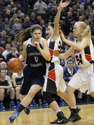 Cameron Onken drives around Olivia Carroll of Barr-Reeve in the Girls Class A Basketball State Final Saturday, March 7, 2015, at Bankers Life Fieldhouse in Indianapolis. CC defeated Barr-Reeve 52-44.