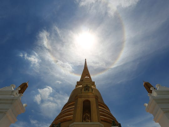 A sun halo is seen in the sky over the pagoda of Wat
