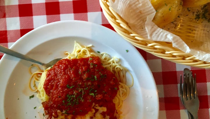 A $5 lunch special featuring eggplant Parmesan, pasta