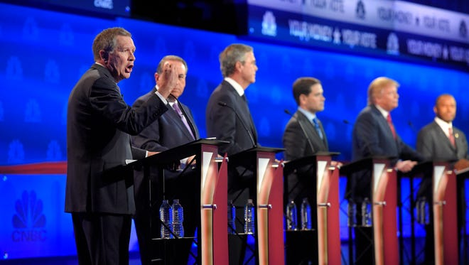 John Kasich, left, has called out Donald Trump, Ben Carson and Jeb Bush -- but not Marco Rubio. (AP Photo/Mark J. Terrill)