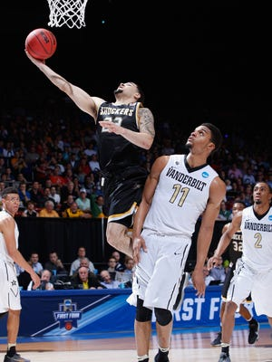 Fred VanVleet of the Wichita State Shockers drives to the basket against Jeff Roberson of the Vanderbilt Commodores in the first half of their game during the first round of the 2016 NCAA Men's Basketball Tournament at UD Arena in Dayton, Ohio.