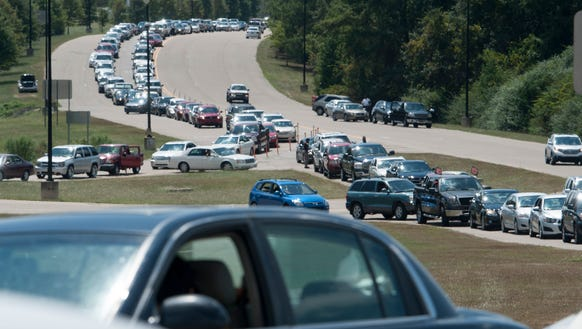 Cars line up for the re-opening of VictoryLand in Shorter,