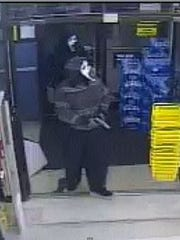 """Police say two men with """"Scream"""" masks robbed a Dollar"""