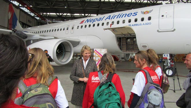 Workers from aid organization Humedica watch as relief supplies are seen on a new Nepal Airlines Airbus A320 in Hamburg, Germany, on April 30, 2015