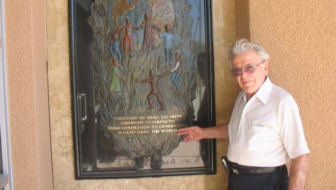 Earl Greif points at a display piece at the Tolerance Education Center in Rancho Mirage in early 2009.