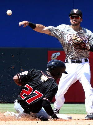 El Paso Chihuahuas second baseman Carlos Asuaje throws to first base after forcing out Cesar Galvez, 27, of the Albuquerque Isotopes at second during the Chihuahuas' final regular season game Monday at Southwest University Park. The Chihuahuas lost 4-2.