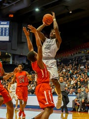 Lakota East's Jarrett Cox dunks the ball against Princeton
