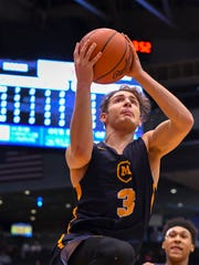Carlos Garcia of Moeller drives to the basket in the