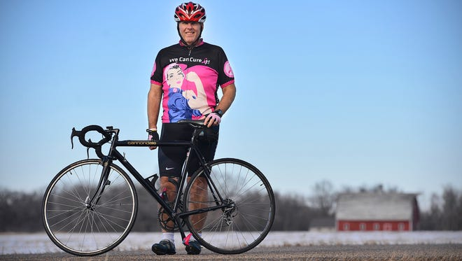 """Al Reszel, Richmond, stands Sunday, Jan. 31 with the bike he plans to use to cycle from Afton to Chicago during a week in June to raise awareness and funds for breast cancer research. Reszel's wife, Terry, is a breast cancer survivor. Reszel, 57, organized the ride titled """"Pink Pedals for a Cure: Terry's Ride 2016."""""""