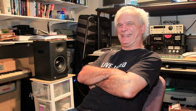 Singer Billy Scherer in his St. Paul basement recording studio. Among other things, he records jingles here.
