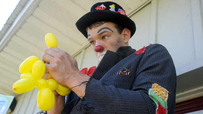 Charlie the Clown makes a poodle balloon during the 2014 Avon Spunktacular Days.