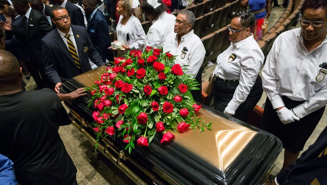 A casket containing the body of Michael Brown is wheeled out Monday at Friendly Temple Missionary Baptist Church in St. Louis. Hundreds of people gathered to say goodbye to Brown, who was shot and killed by a Ferguson, Mo., police officer on Aug. 9.