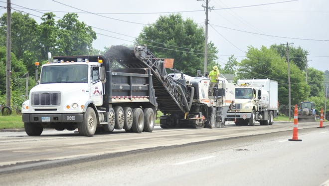 Workers begin a resurfacing project Monday on Ohio 39 between Mansfield and Shelby.