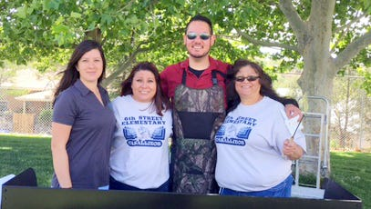 From left. are Maggie Veeder, Lisa Serna, Antonio Quesada and Mary Ybarra, all employees of First New Mexico Bank of Silver City where they bank like family.
