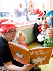 Lauren Clapper reads 'Horton Hears a Who' to children