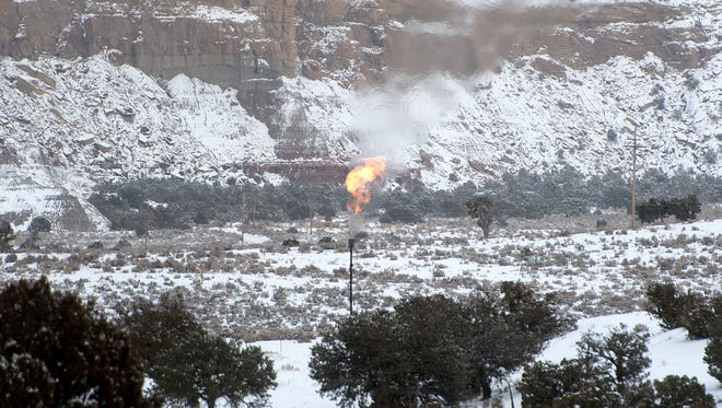 Natural gas flares from a production site on Jan. 8 off U.S. Highway 550 near Lybrook.