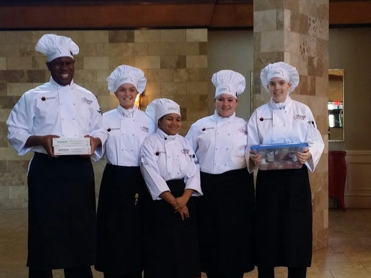 Jordan Cooper (from left), Kelsea Wulff, Erayna Greenwood, Kelsey Parsons and Sara Brooks are showns right before product check in during competition.