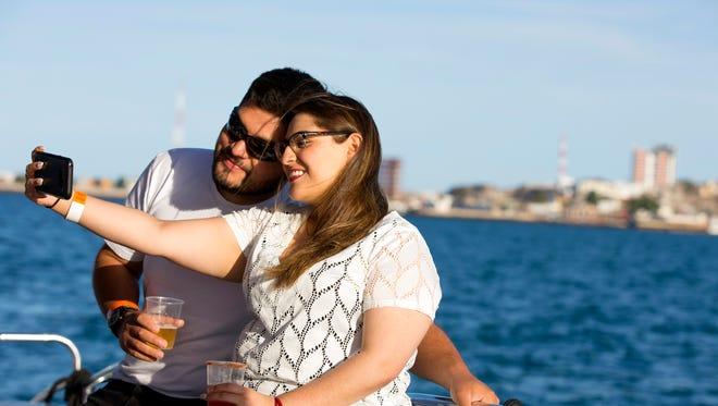 Newlyweds Orlando Cruz and Daniela Celaya, of Tucson, take a selfie during a EcoFun sunset cruise in  Puerto Penasco, Mexico.