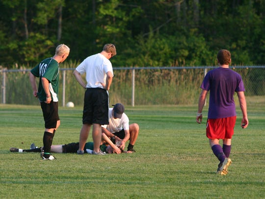 high school soccer player is injured
