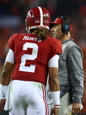 Alabama Crimson Tide offensive coordinator Steve Sarkisian talks strategy with quarterback Jalen Hurts.