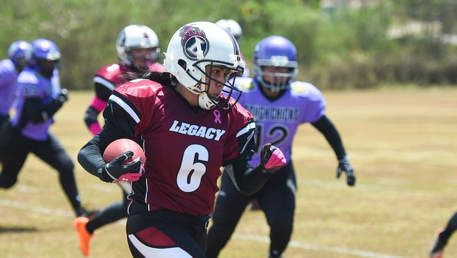 Legacy's Shawnell Castro (6) runs the ball against the Tough Chicks during their Guam Women's Tackle Football League game at the University of Guam Field in Mangilao on April 30. Legacy came away with the victory 32-0.