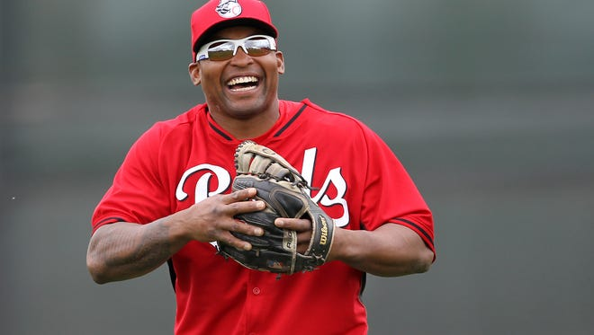Reds outfielder Marlon Byrd smiles as he warms up at spring training in Goodyear on March 1.