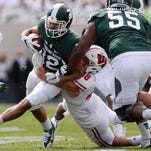 Senior wide receiver R.J. Shelton is brought down by Wisconsin Jack Cichy during the game against Wisconsin on Saturday, Sept. 24, 2016 at Spartan Stadium in East Lansing. Wisconsin defeated Michigan State, 30-6.
