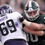 Senior linebacker Riley Bullough blocks offensive lineman Brad North during the game against Northwestern on Saturday, Oct. 15, 2016 at Spartan Stadium in East Lansing. Northwestern defeated MSU, 54-40.