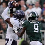 Northwestern Jared McGee intercepts a pass intended for freshman wide receiver Donnie Corley during the game against Northwestern on Saturday, Oct. 15, 2016 at Spartan Stadium in East Lansing. Northwestern defeated MSU, 54-40.