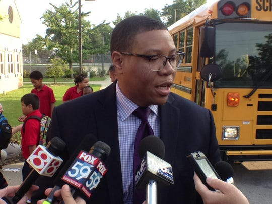 IPS Superintendant Dr. Lewis Ferebee talks with media outside  Indianapolis Public School 14 on Aug. 4, 2014, the first day back to school.