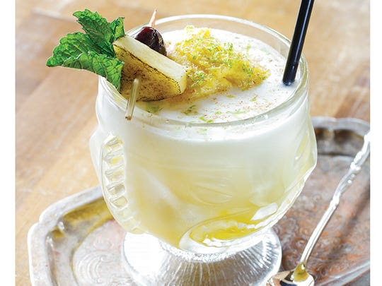 This tiki-style drink from Roux has unexpected flavors such as curry, nutmeg, pineapple and more.