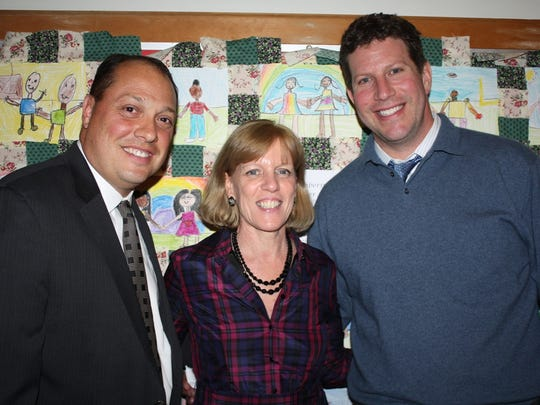 Joseph Mosey, Mary Foster, and David Fine, of the Peekskill school district. Foster is set to become the district's interim superintendent July 1.