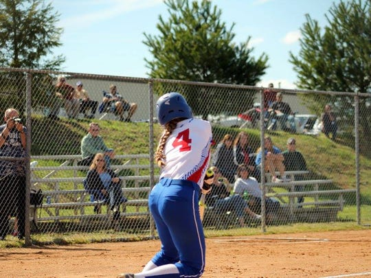 Hannah Jennings hits left during a softball game.