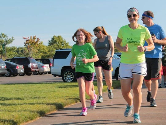 Betsey Ingraham runs, bikes and swims for those in