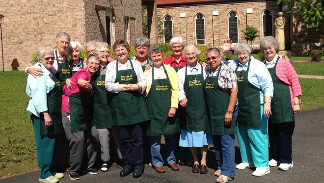 Sister Peggy Jackelen, right, applied for the grant that funded recent technology upgrades to Bell Tower Residence's Assisi Hall. She is pictured in 2013 with Sisters Mary Anne Rose, Linda Songy, Anita Hirt, Kathy Wiesneski, Dorothy Niemann, Ann Wittman, Kathy Lange, Pam Hodgson, Helen Huss, Mary Thomas Reichl, Loretta Schreiber, John Marie Simien and Mary Michael Smits.