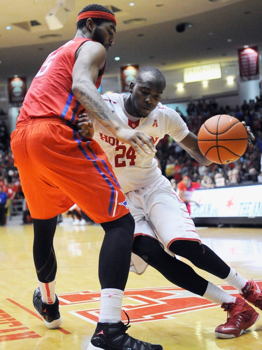 Houston's Devonta Pollard (24) drives the ball around SMU's Markus Kennedy (5) during the second half of an NCAA college basketball game Monday, Feb. 1, 2016, in Houston. Houston won 71-68 for an upset. (AP Photo/Pat Sullivan)