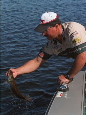 Professional walleye angler Mike Gofron lands a pike from Lake Gogebic.