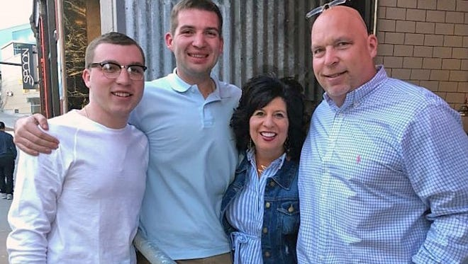 New Creekview Elementary School Principal Michelle Peterson is pictured with her family, from left, Cole, Austin and John.