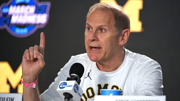 Michigan head coach John Beilein speaks during a news