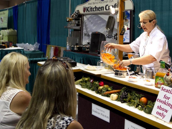 Kitchen Craft Chef Darlene Payton demonstrates the use of waterless cookware at the 18th annual Winter Home & Garden Show at Harborside Event Center in downtown Fort Myers Sunday. Some Exhibitors included Cutco, Storm Solutions, CoolAir, Stilwell Solar, Tropical Pools, Elting's Exotic Plants, Rao Collection and Sharon's Lovely Linens.
