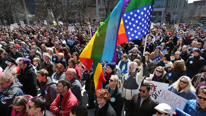 Several thousand opponents of Indiana's Religious Freedom Restoration Act hold a rally on the steps of the Statehouse in Indianapolis on Saturday, March 28, 2015