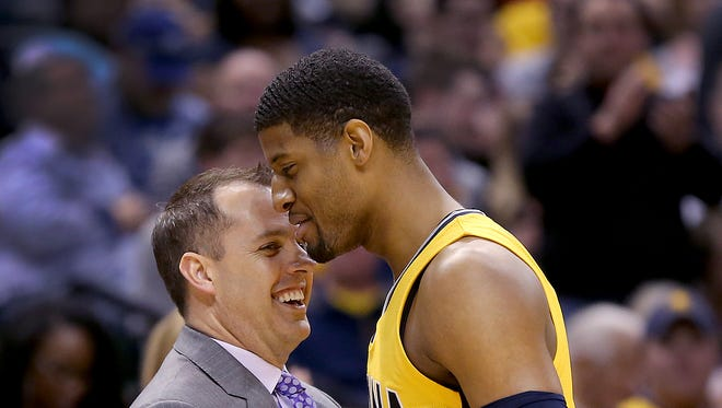 Pacers forward Paul George (13) shares a moment with coach Frank Vogel, April 5, 2015, at Bankers Life Fieldhouse.