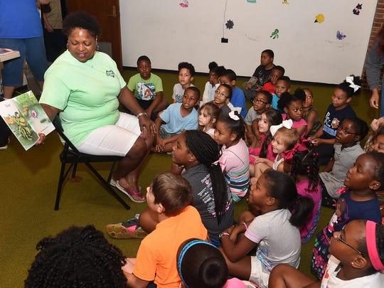 Melanie Chavis holds the attention of the children as she reads stories during Storytime at the Opelousas Public Library.
